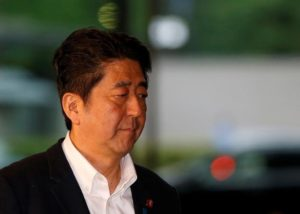 Japan's Prime Minister Shinzo Abe arrives at his official residence for attending a meeting of relevant cabinet ministers to discuss Britain's exit from the European Union, in Tokyo, Japan, June 24, 2016.