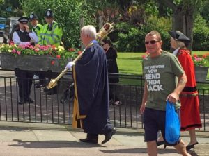 A man wearing an anti immigration T-shirt walks during Armed Forces Day Parade in Romford, England, Saturday 25 June 2016