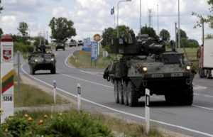 U.S. troops cross the Lithuanian-Latvian border during tactical road march Dragoon Ride II in Subate, Latvia, June 6, 2016.