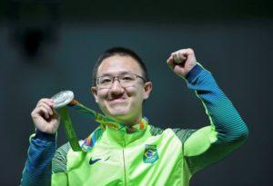2016 Rio Olympics - Shooting - Victory Ceremony - Men's 10m Air Pistol Victory Ceremony - Olympic Shooting Centre - Rio de Janeiro, Brazil - 06/08/2016. Felipe Wu (BRA) of Brazil shows his silver medal.