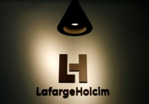 The company's new logo is pictured at the headquarters of LafargeHolcim in Zurich, Switzerland, July 15, 2015.