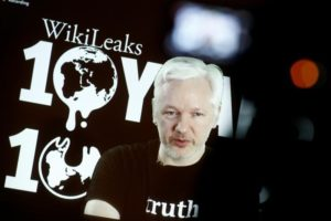 Julian Assange, Founder and Editor-in-Chief of WikiLeaks speaks via video link during a press conference on the occasion of the ten year anniversary celebration of WikiLeaks in Berlin, Germany, October 4, 2016.