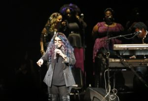 Tyka Nelson, Prince's sister, appears on stage during a tribute concert honoring the late musician at Xcel Arena, Thursday, Oct. 13, 2016, in St. Paul, Minn. Prince died in April of an accidental overdose.