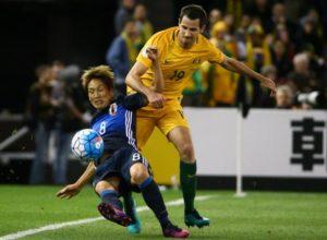 Genki Haraguchi of Japan in action with Ryan McGowan of Australia. Australia v Japan - World Cup 2018 Qualifier - Docklands stadium - Melbourne, Australia - 11/10/16. .
