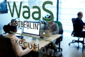 """Employees of the """"Website as a Service"""" (WaaS) company MBJ sit in their office in Berlin, Germany October 18, 2016."""