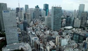 Japan government raises view on output in gradual economic recovery