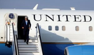 U.S. Secretary of State John Kerry leaves his plane as he arrives at Kigali international airport in Rwanda capital to promote U.S. climate and environmental goals at the Meeting of the Parties to the Montreal Protocol on the elimination of hydro fluorocarbons (HFCs) use, October 13, 2016.