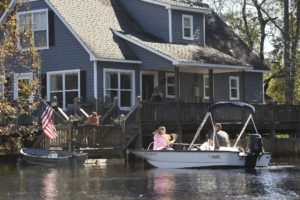 Residents use their boats to get through flood waters from the North East Cape Fear River in the Riverbend Subdivision off Hwy 53 Thursday, Oct. 13, 2016. Flood waters from Hurricane Matthew are starting to crest in Burgaw, N.C. along Hwy 53 but are still heading down river towards Wilmington.