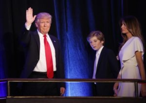 U.S. Republican presidential nominee Donald Trump arrives to speak at his election night rally with his son Barron and wife Melania in Manhattan, New York, U.S., November 9, 2016.