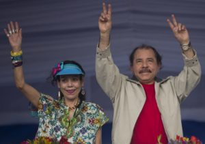 July 3, 2016 file photo Nicaragua's President Daniel Ortega, right, and first lady Rosario Murillo, wave to supporters during an event commemorating the 36th anniversary of the Sandinista National Liberation Front withdrawal to Masaya, in Managua, Nicaragua. Murillo now running