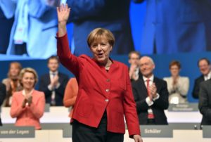 German Chancellor and Chairwomen of the CDU, Angela Merkel, waves after her speech as part of a general party conference of the Christian Democratic Union (CDU) in Essen, Germany, Tuesday, Dec. 6, 2016.