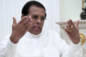 Sri Lanka leader pledges to consult Buddhist leaders over new constitution