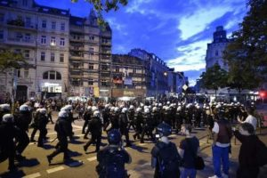 Dozens of police injured in G20 protests as Merkel seeks consensus