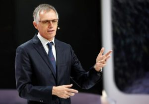 Peugeot lifts profitability goal on record year